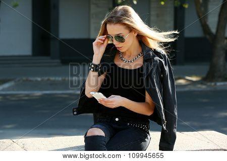 Beautiful young girl posing on city street