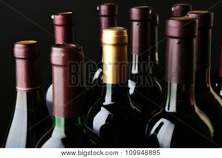 Wine bottles neck on dark background, close up