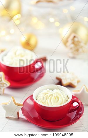 Beautiful composition with cups of cappuccino and Christmas cookies
