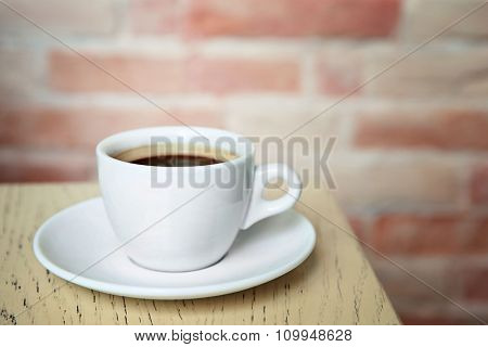 Cup of tasty coffee on cafe background