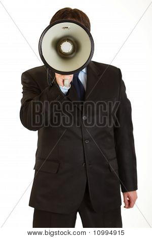 Businessman standing in front of camera and speaking into megaphone