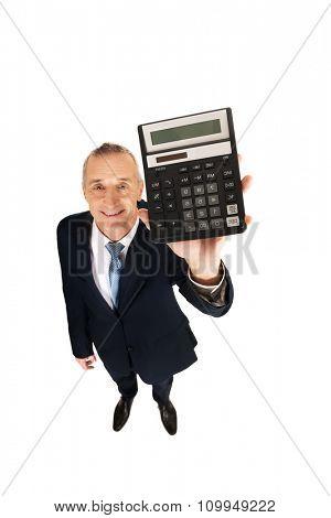 Happy mature businessman holding a calculator.
