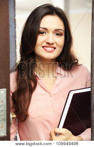 Friendly female estate-agent, indoor