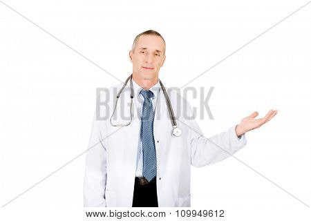 Mature male doctor holding copyspace.