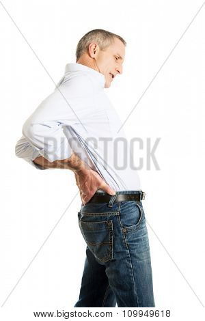 Mature man suffering from back pain.