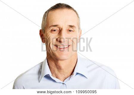 Smiling good looking mature man.
