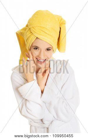 Smiling spa woman in bathrobe.