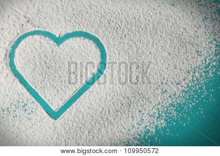 Heart of flour on color wooden background