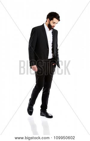 Young depressed businessman looking down.