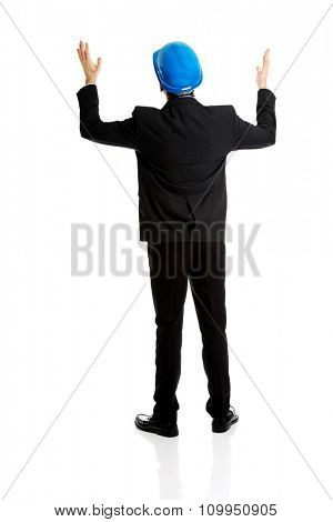 Happy engineer businessman showing empty copyspace on hands.