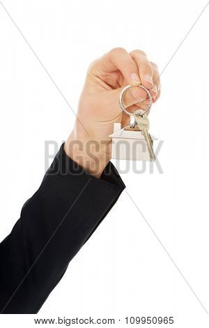 Realtor's hand is giving the keys to an apartment to some clients.