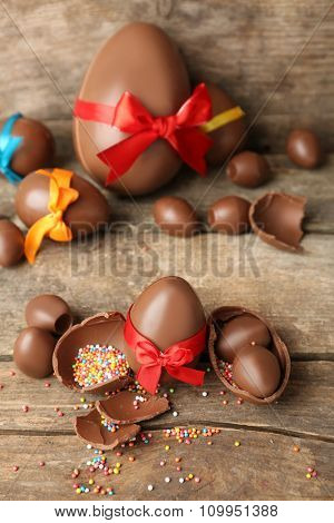 Chocolate Easter eggs on wooden background