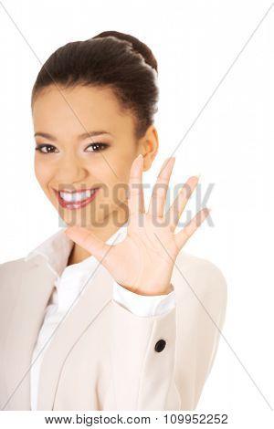 African businesswoman gesturing five in hand.