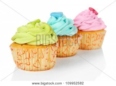 Tasty cupcakes isolated on white background