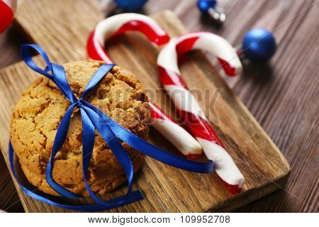 Christmas Candy Canes with Christmas decoration on table close-up