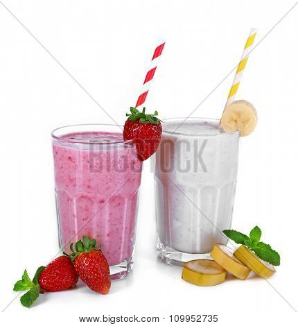 Glasses of fresh cold smoothie and fruit, isolated on white