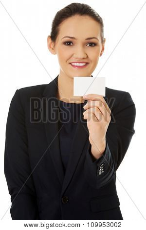 Young happy businesswoman holding small empty card.