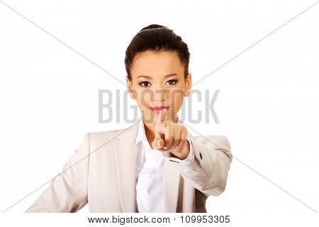 Happy african businesswoman pointing on you.