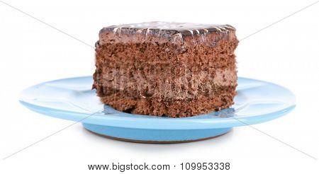 Sweet chocolate cake on blue plate isolated on white background