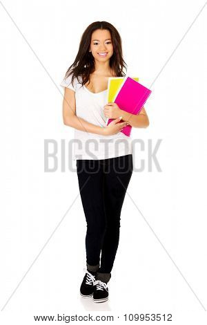 Young african student woman with notes.