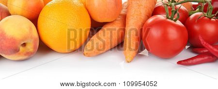 Colourful fruit and vegetables composition in a row isolated on white