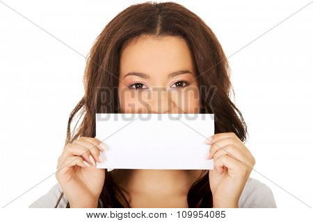 Young happy african teen with blank paper.