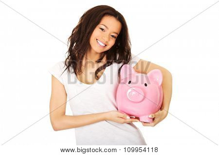 Happy african woman with piggybank.