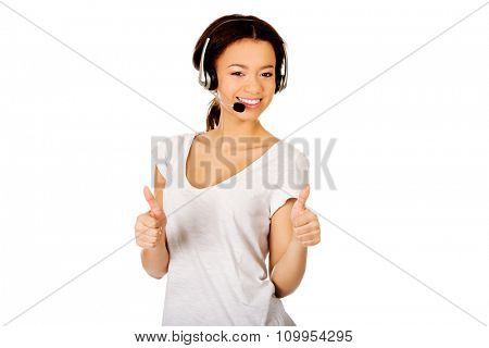 African call center operator with thumbs up.