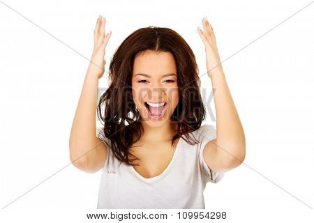 Young angry african woman with hands up.