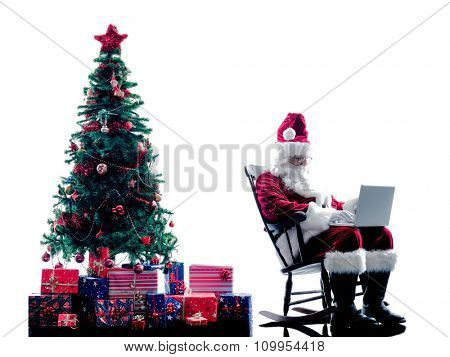 one santa claus man using laptop computer silhouette isolated on white background