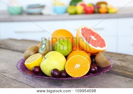 Fresh fruits on table in kitchen, close up