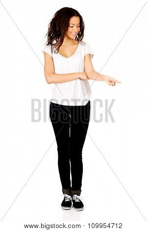 Young student african woman pointing down.