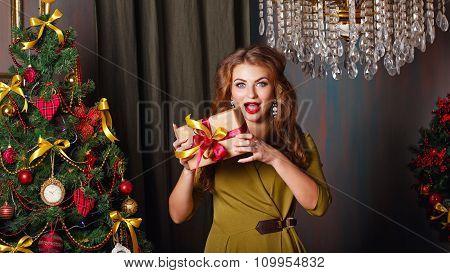 Girl Is Happy The Present. Christmas Tree.
