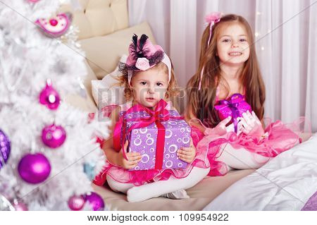 Two Girls With Gifts For Christmas.