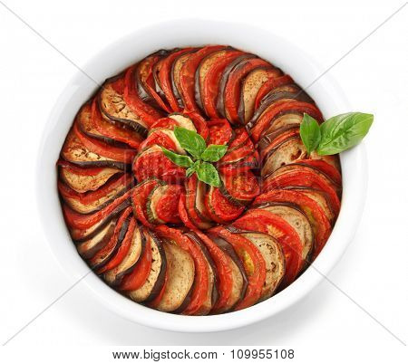 Ratatouille - traditional French Provencal vegetable dish cooked in oven, isolated on white