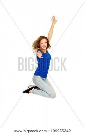 Young beautiful happy woman jumping.