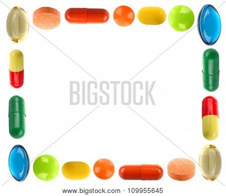 Frame made of different pills isolated on white