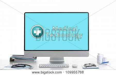 Computer on doctor table, concept of medical technology