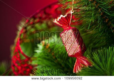 branch of Christmas tree with candy