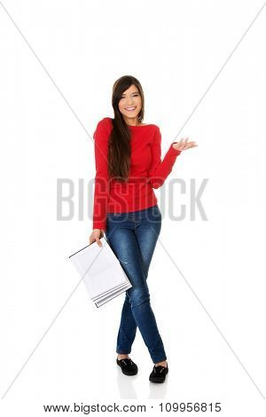 Laughing young student woman with her note.
