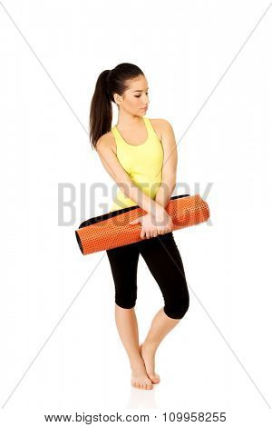 Wxercise fitness woman ready for workout with yoga mat.