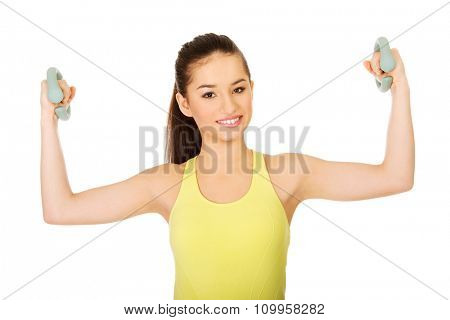 Fitness woman exercising with weights.