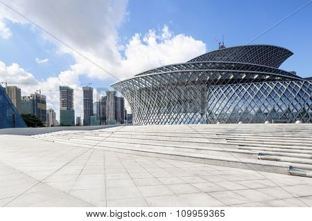 Dong ying, Shandong, China-8,July,2015:skyline, empty ground and Dongying Snow-Lotus Grand Theatre in Blue sky