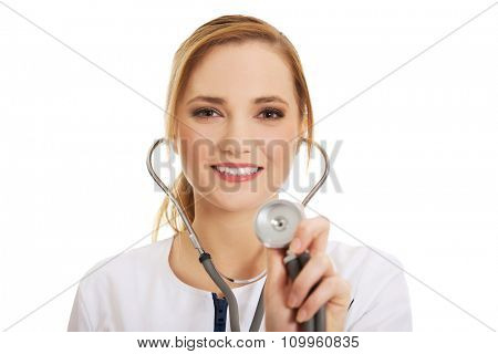 Young happy female dentist with stethoscope.