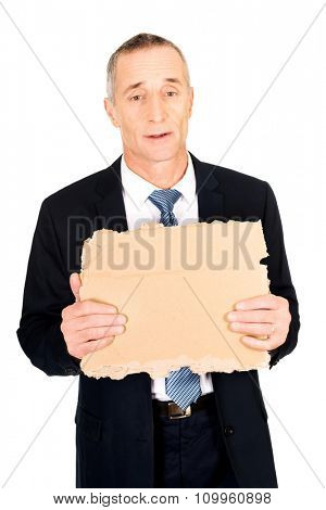 Mature businessman with a piece of cardboard