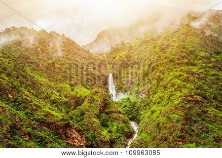 Beautiful mountains landscape with waterfall and clouds in Nepal, Annapurna trekking
