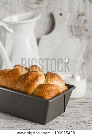 Homemade Bread Brioche In The Baking Dish On A Light Rustic Wooden Background