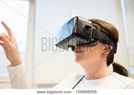 Businesswoman using oculus rift headset in the office