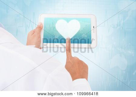 Doctor hand touch screen heart symbol on a tablet. medical icon
