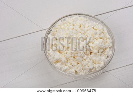 Cottage Cheese In Bowl On White A Wooden Surface